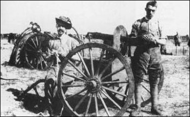 Canadian troops cleaning a Colt machine gun in South Africa
