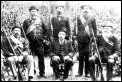 Boer veterans. Note the Transvaal State Artillery coat of the man standing first on left*