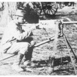 Boer fighter testing a Maxim machine gun