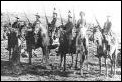 On commando - mounted burghers pose in the field. Note the entirely different riding style to British mounted troops**